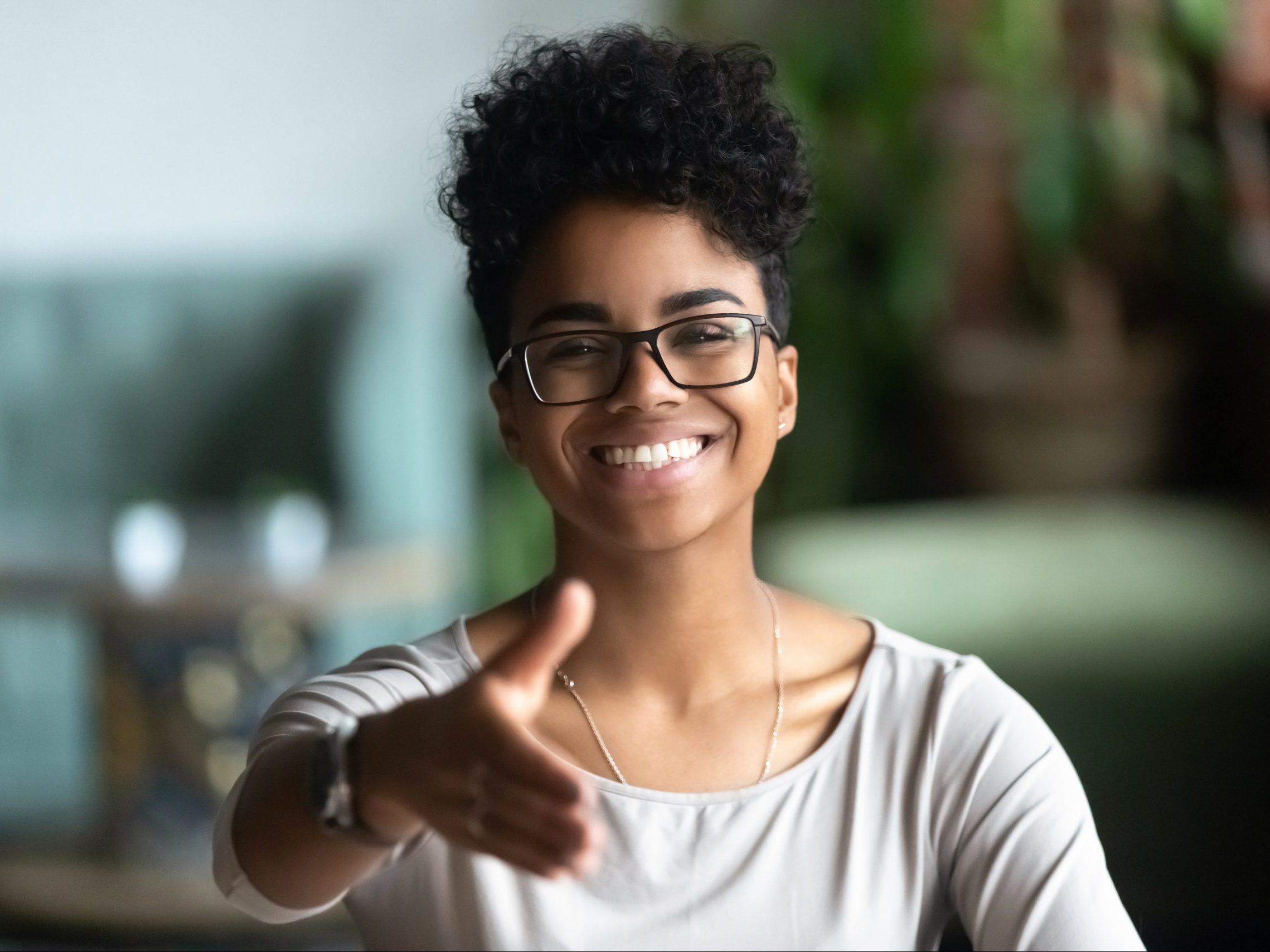 Happy,African,American,Young,Woman,In,Glasses,Stretch,Hand,For