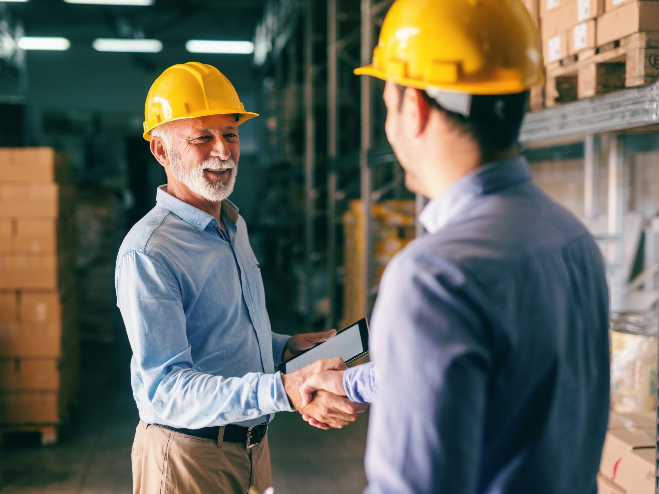 Two,Businessmen,Shaking,Hands,For,Successful,Business,While,Standing,In