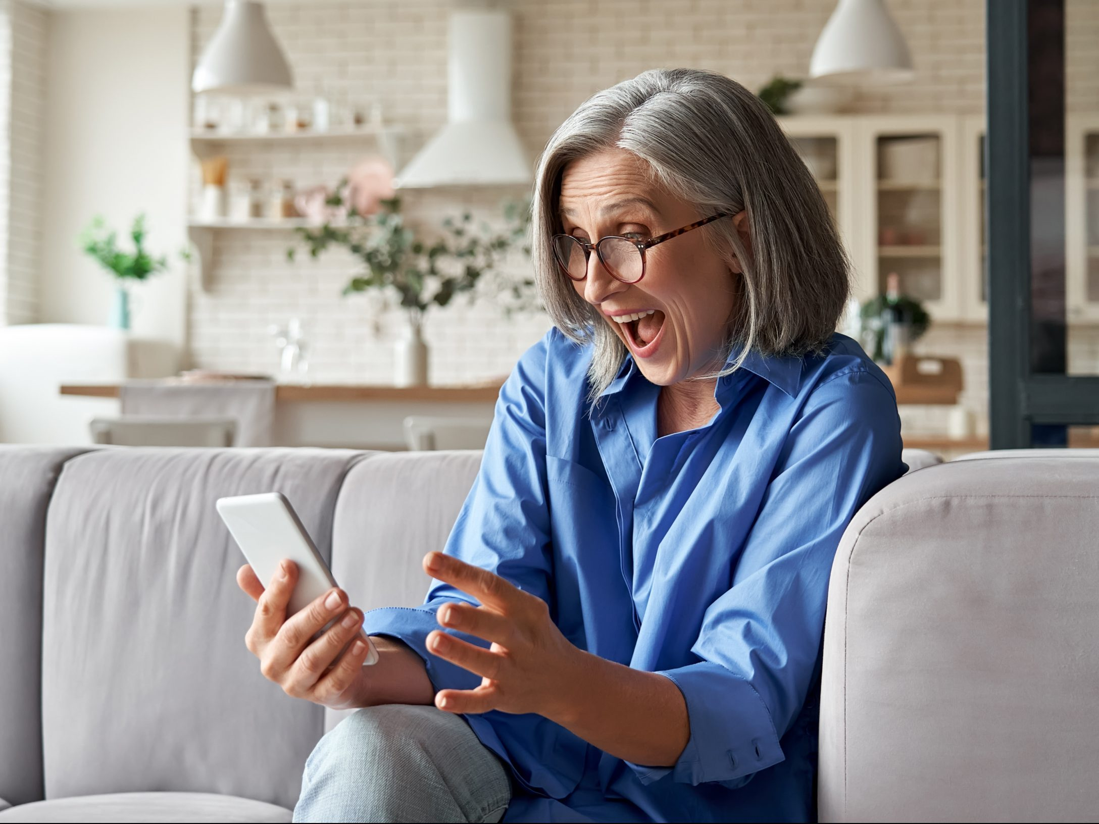 Amazed,Happy,Mature,Older,60s,Woman,,Excited,Customer,Holding,Smartphone